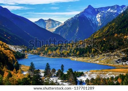 A lake in autumn mountains (Spain, Pyrenees) - stock photo