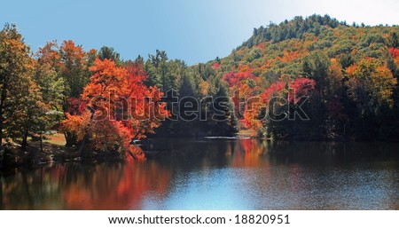A lake in New England on a crisp autumn day. - stock photo