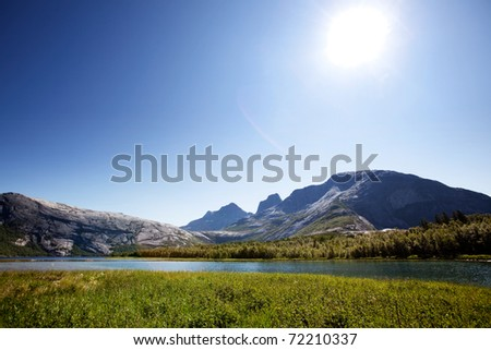 A lake landscape with moutain in northern Norway - stock photo