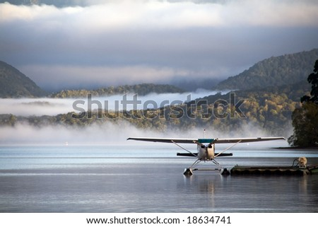 A landed waterplane - in the foggy hills - stock photo