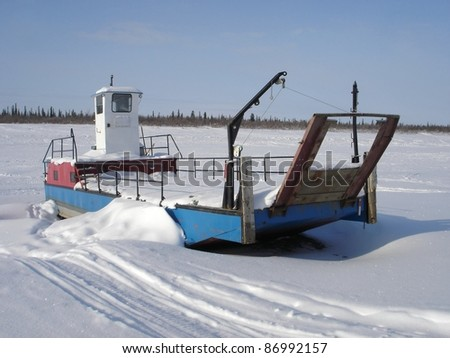A landing barge waits for the spring thaw on the east channel of the Mackenzie River near Inuvik, Northwest Territories.
