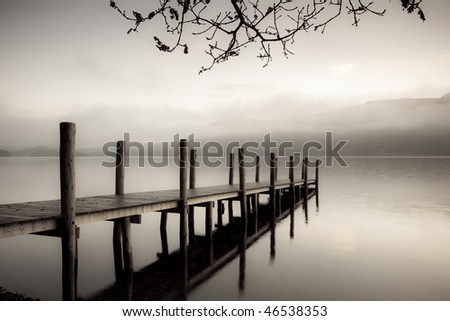 A landing jetty at Derwent water on a misty Autumn morning