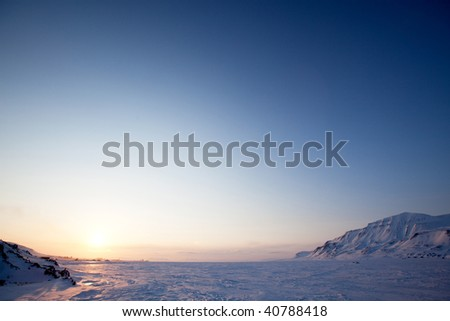 A landscape on the island of Spitsbergen, Svalbard, Norway late at night. View from Longyearbyen. - stock photo