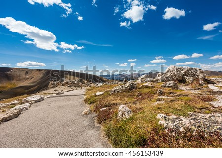 A landscape view of a peak in the Rocky Mountains with trail path in Colorado, USA - stock photo