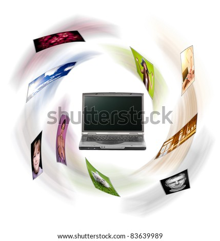 A laptop and digital pictures flying. All photos can be found in my portfolio. - stock photo