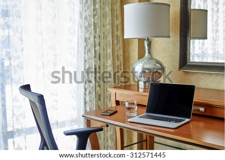 a laptop computer and office chair - stock photo