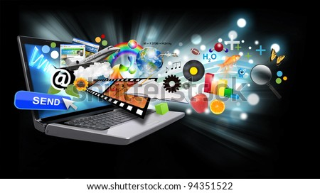 A laptop has many objects projecting out of the screen on a black background with glowing light. Use it for an email download concept or internet research idea. - stock photo