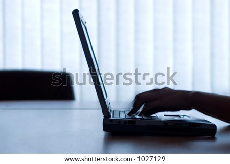 A laptop in the office. Very nice light. - stock photo