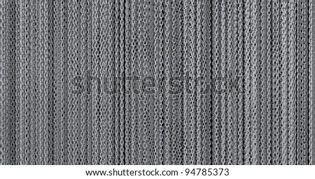 A large amount of silver looking chains hanging in a curtain fashion - stock photo