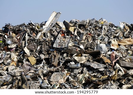 A large amount of trash and debris in a pile. - stock photo