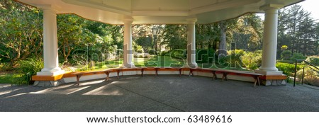 A large beautiful gazebo with study pillars supporting it on a cement pad. Inside panorama of the interior. - stock photo