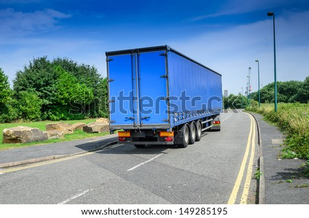 A large blue truck/lorry in England, UK