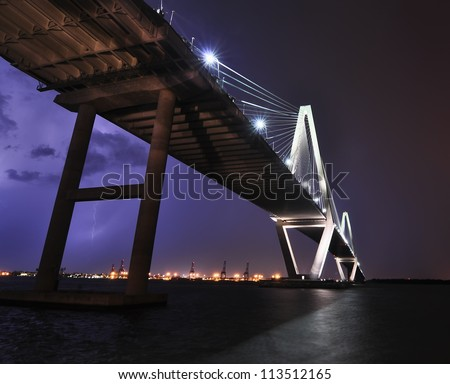 A Large Bolt of Lightning Over the Cooper River Bridge - stock photo