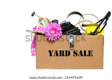 A large cardboard box filled with Yard Sale or Tag Sale items to be sold at a discount in order to make room and make some money at the same time. Yard Sales are an important part of our economy
