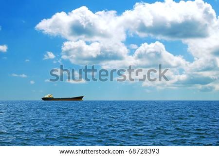 A large cargo ship at sea - stock photo