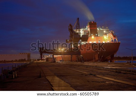 A large cargo ship at the port wharf. - stock photo