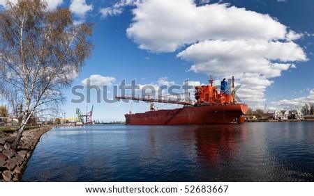A large cargo ship in the shipyard in Gdansk, Poland. - stock photo