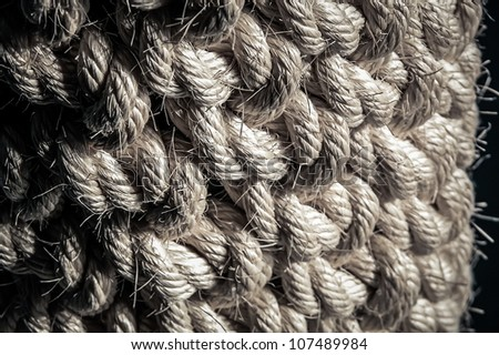 A large circle of big thick and old rope.