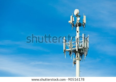 A Large Communications Tower on a Blue Sky - stock photo