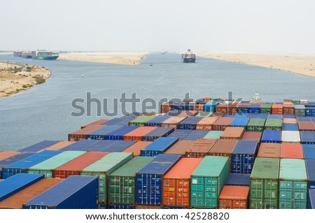 a large container vessel ship passing suez canal