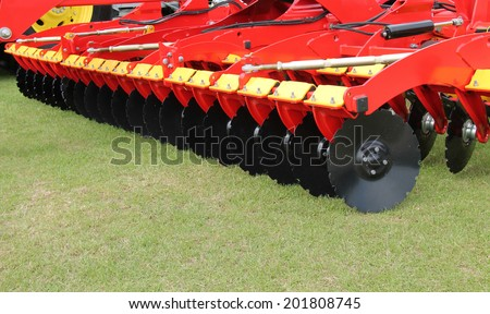 A Large Disc Harrow Trailer for a Farming Tractor. - stock photo