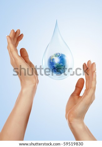 A large drop of water and hands to support it. The symbol of environmental protection. - stock photo