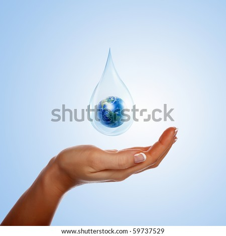 A large drop of water with Earth inside and hands to support it. The symbol of environmental protection. - stock photo