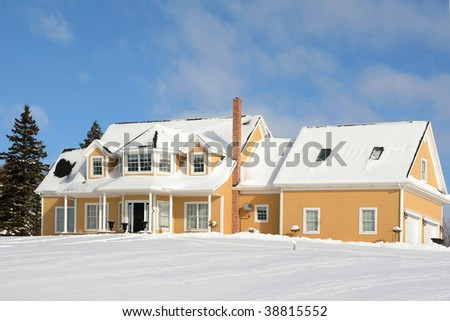 A large family home buried in snow in the depths of winter. - stock photo