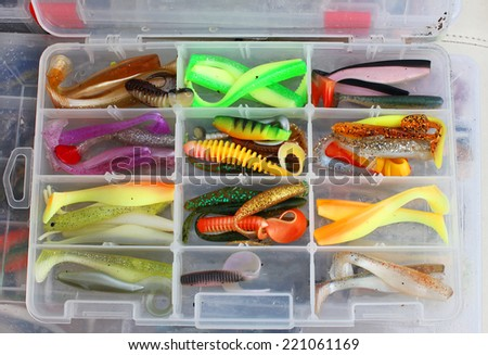 A large fisherman's tackle box fully stocked with lures and gear for fishing - stock photo