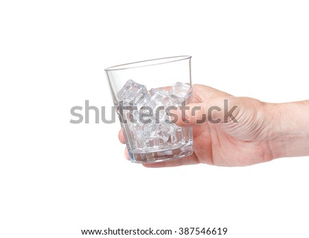a large glass for whiskey with ice in his hand isolated on white background