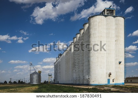 A large grain silo in a rural town - stock photo