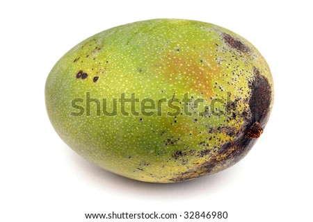 a large green uncut mango fruit on white surface