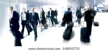 A large group of arriving business people. Panorama. Motion blur. - stock photo
