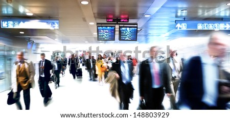 A large group of arriving business people. Panorama. Motoin blur. - stock photo