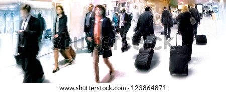 A large group of arriving businessmen. Panorama. Motion blur. - stock photo