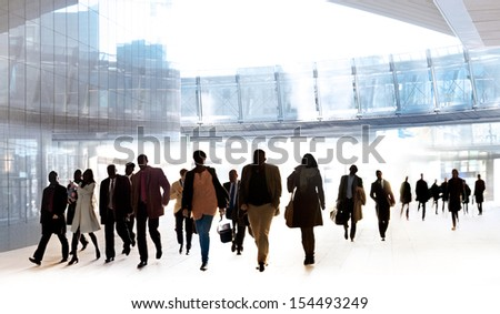 A large group of business people walking. Urban scene.