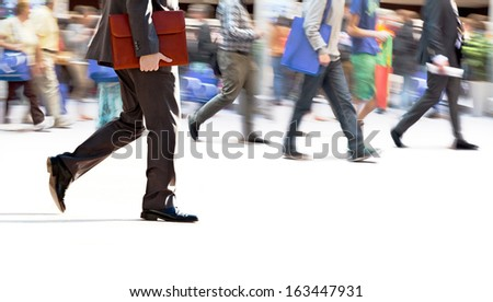 A large group of people walking. Blurred motion