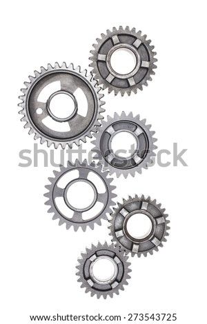 A large group of steel gears are linked together on a white background. - stock photo