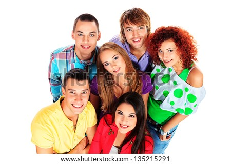 A large group of young people standing together and looking up. Friendship. Isolated over white. - stock photo