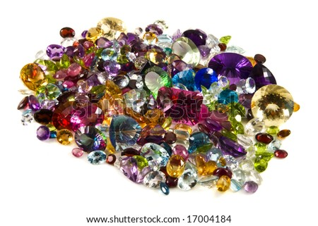 A large grouping of faceted gemstones on a white background - stock photo