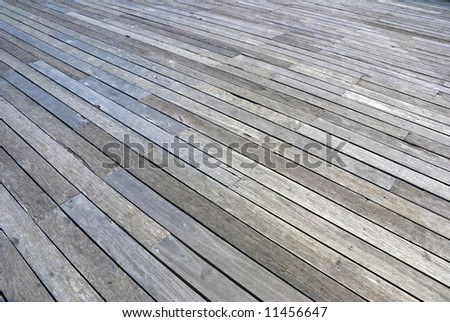 a large hardwood plank floor on a dock by the quay