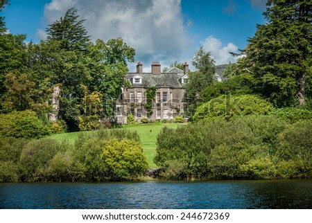 A large house on an island on Lake Derwentwater in Keswick, Cumbria. - stock photo