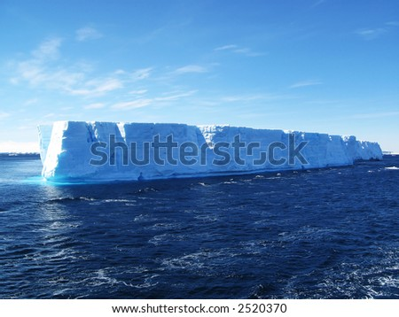 A large iceberg floating in the ocean in Antarctica