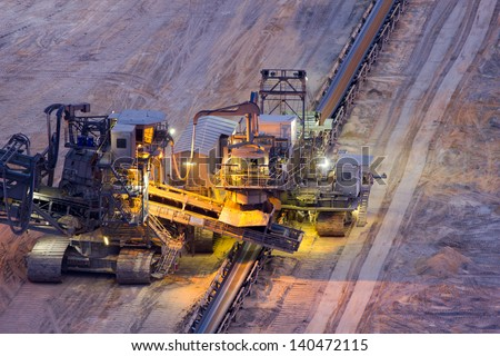 A large industrial conveyor-belt in a brown-coal mine - stock photo