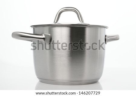 A large kitchen pot with a lid, on plain background with a natural reflection under it.