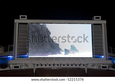 A large LED Television outside on a pool deck - stock photo