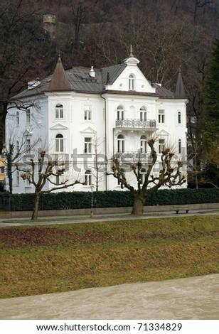 A large luxury home beside the Salzach River, Salzburg, Austria - stock photo
