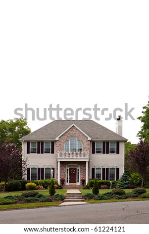 A large luxury home isolated over white.  Plenty of white negative space for your text or design. - stock photo