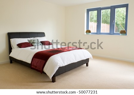 A large master bedroom in a newly built property - stock photo
