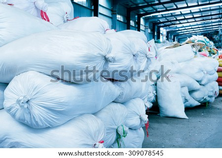 A large number of bags in the warehouse. - stock photo